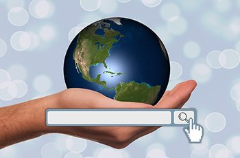 Hand holding a globe - internet search visibility